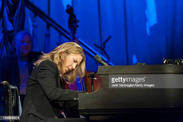 Canadian jazz musician Diana Krall plays piano with her quartet at the Box New York New York September 24 2012 Bassist Dennis Crouch is visible in...