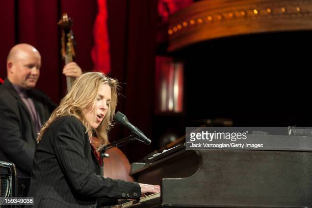 Canadian jazz musician Diana Krall plays piano with her quartet including bassist Dennis Crouch at the Box New York New York September 24 2012