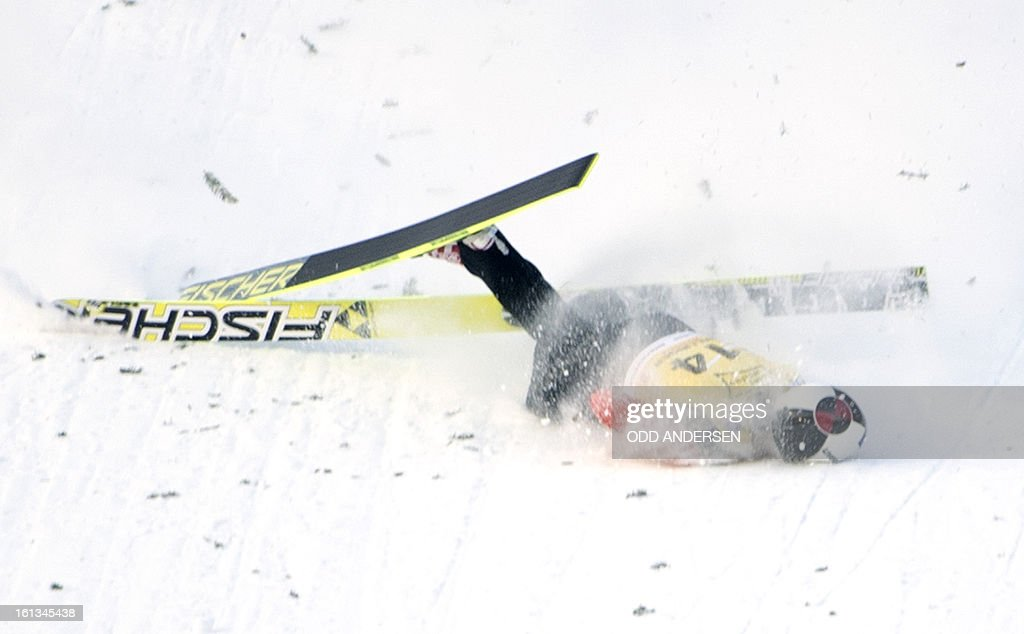 Canadian jumper MacKenzie Boyd-Clowes crashes during a show jump after the cancellation of the FIS Ski Jumping World Cup individual large hill competition on the Muehlenkopfschanze hill in Willingen, western Germany on February 10, 2013.