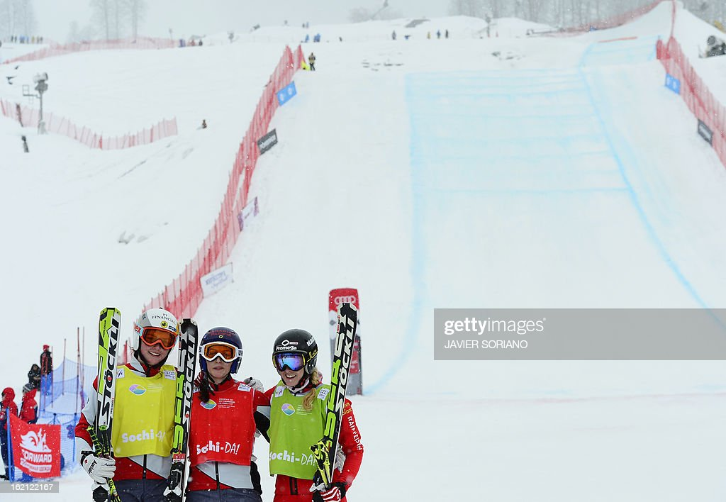 Canadian Kelsey Serwa (C), Canadian Marielle Thompson (L) and Swiss Fanny Smith pose on finish line after the Ladies' Ski Cross final race at the Snowboarding and Free Style World Cup Test Event at the Snowboard and Free Style Center in Rosa Khutor near the Russian Black Sea resort of Sochi on February 19, 2013. Canadian Kelsey Serwa won the race ahead of Canadian Marielle Thompson and Swiss Fanny Smith.