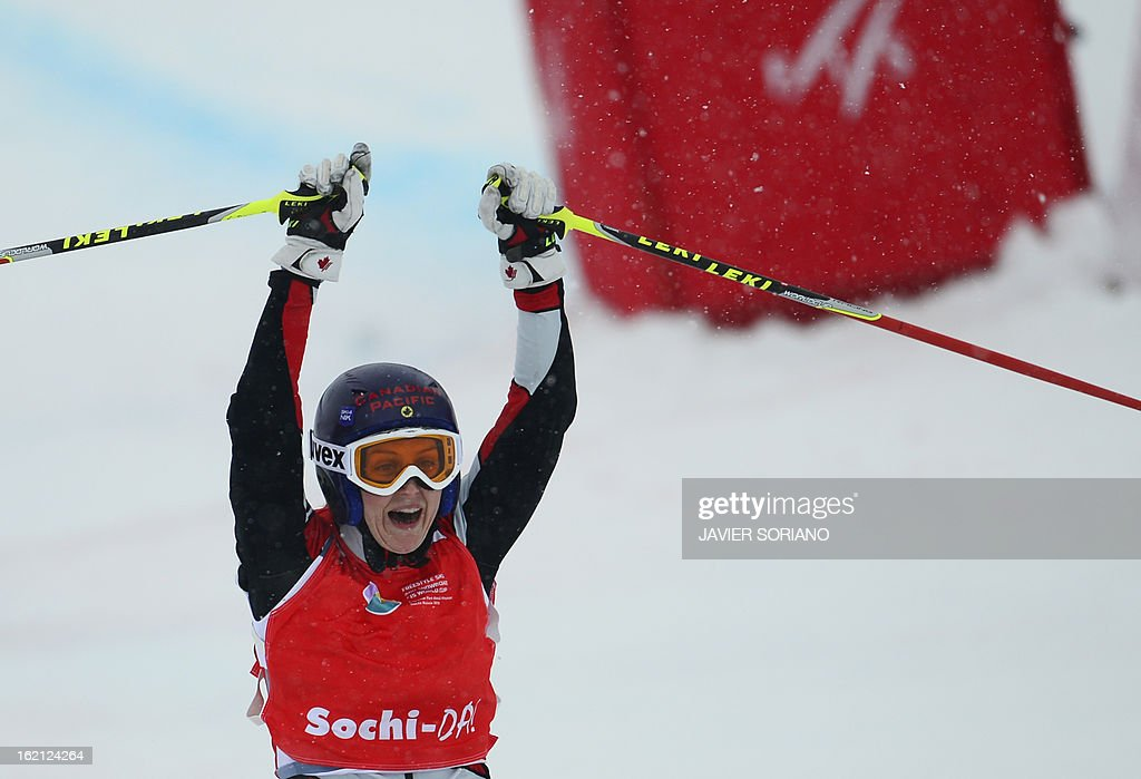 Canadian Kelsey Serwa celebrates her victory on the finish line during the Ladies' Ski Cross final race at the Snowboarding and Free Style World Cup Test Event at the Snowboard and Free Style Center in Rosa Khutor near the Russian Black Sea resort of Sochi on February 19, 2013. Canadian Kelsey Serwa won the race ahead of Canadian Marielle Thompson and Swiss Fanny Smith.