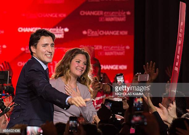 Canadian Liberal Party leader Justin Trudeau and his wife Sophie greet supporters in Montreal on October 20 2015 after winning the general elections...