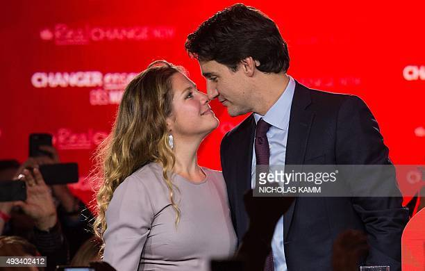 Canadian Liberal Party leader Justin Trudeau and his wife Sophie look at each other on stage in Montreal on October 20 2015 after winning the general...