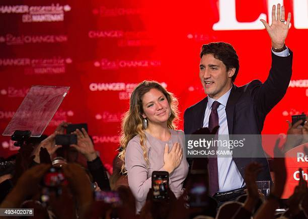 Canadian Liberal Party leader Justin Trudeau and his wife Sophie wave on stage in Montreal on October 20 2015 after winning the general elections AFP...