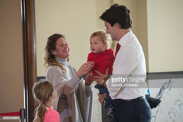 Canadian Liberal Party leader Justin Trudeau waits with his wife Sophie son Hadrien and daughter EllaGrace to cast his ballot in Montreal on October...
