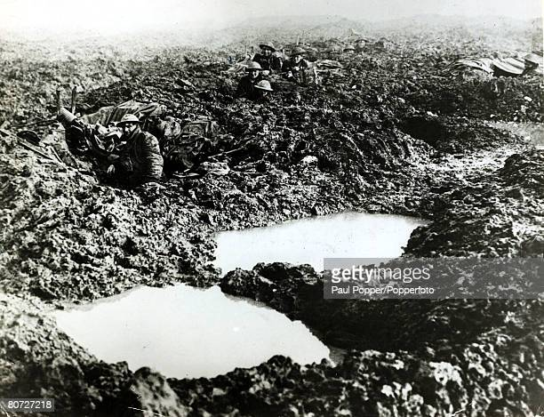Canadian machine gunners manning shell holes at Passchendaele in atrocious conditions during World War I 14th November 1917