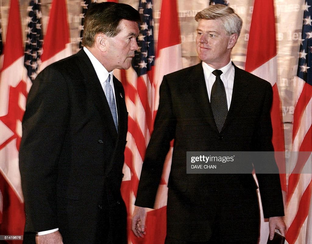 Canadian Minister of Foreign Affairs John Manley and United States Director of Homeland Security Tom Ridge leave a joint news conference 11 December...