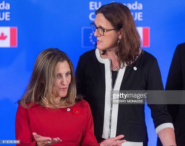 Canadian Minister of International Trade Chrystia Freeland gestures next to European Trade Commissioner Cecilia Malmstrom after the signing of the...
