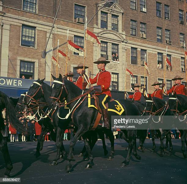 Canadian Mounties on horseback during a parade circa 1960