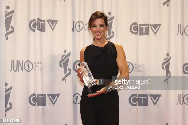 Canadian Music Hall of Fame inductee Sarah McLachlan poses for pictures with her JUNO award at the Canadian Tire Centre in Ottawa Canada April 2 2017...