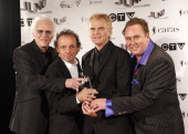 Canadian Music Hall of Fame Inductees Paul Dean Matt Frenette Doug Johnson and Mike Reno of Loverboy pose with their award in the press room at the...