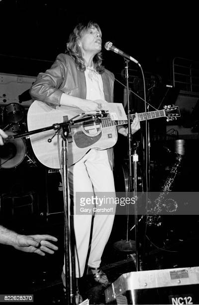 Canadian musician Joni Mitchell plays acoustic guitar as she performs on stage at Studio 54 New York New York April 2 1982 The performance was part...