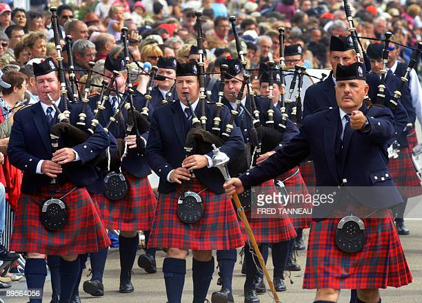 Canadian musicians of the 'Toronto Police Pipe Band ' parade playing bagpipes on August 2 2009 in Lorient western France during the celtics nations...
