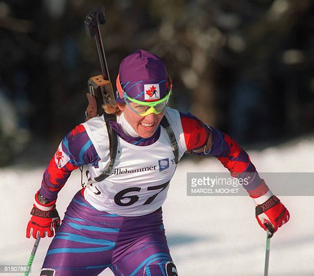 Canadian Myriam Bedard grimaces as she powers her way to the gold medal during the women's 15km individual biathlon at the Winter Olympic Games 18...