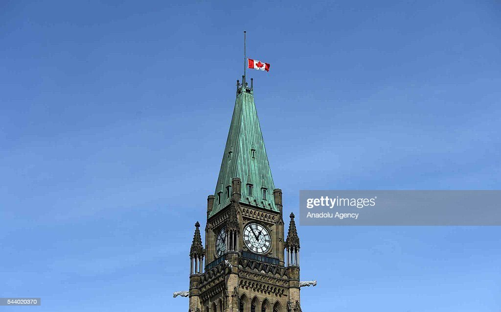 Canadian national flag flies at half mast over the Peace Tower in Ottowa, Canada on June 30, 2016 following the recent terrorist attack at Istanbul Ataturk International Airport.