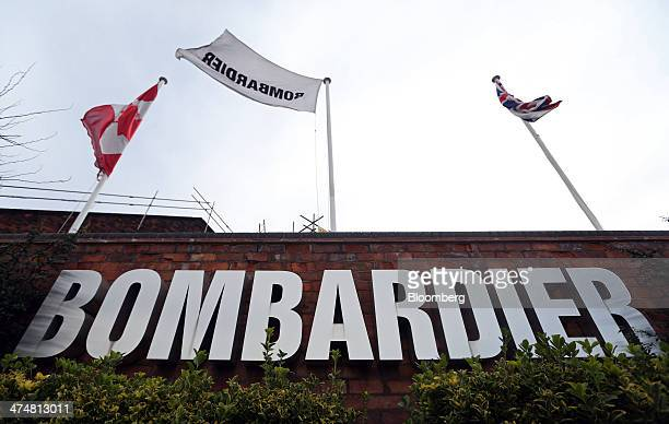 A Canadian national flag left flies alongside a British Union flag right and a Bombardier flag outside Bombardier Inc's Litchurch Lane railcar...