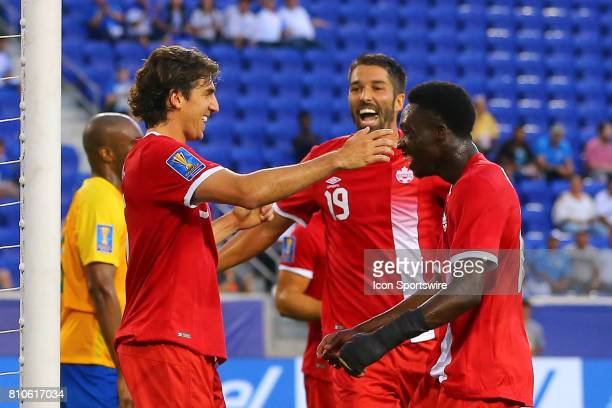 Canadian National Soccer Team defender Dejan Jakovic celebrates with teammates after scoring during the first half of the CONCACAF Gold Cup Group A...