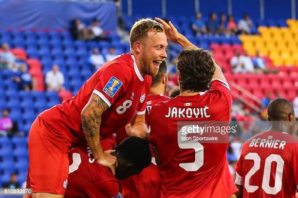 Canadian National Soccer Team midfielder Scott Arfield celebrates with Canadian National Soccer Team defender Dejan Jakovic during the first half of...