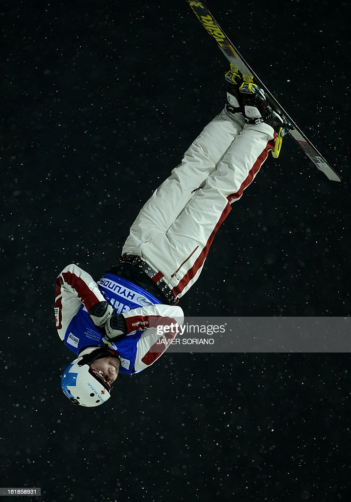 Canadian Olivier Rochon competes during the Men's FreeStyle Aerials final race at the Snowboarding and Free Style World Cup Test Event at the Snowboard and Free Style Centre in Rosa Khutor near the Russian Black Sea resort of Sochi on February 17, 2013.Chinese Guangpu Qi won the race ahead of Chinese Zhongqing Liu and Belorussian Denis Osipau.
