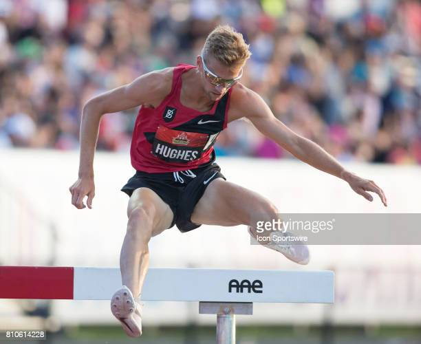 Canadian Olympian Matt Hughes clears a barrier and runs to a victory and a world championship qualifying time in the men's 3000m steeple chase at the...