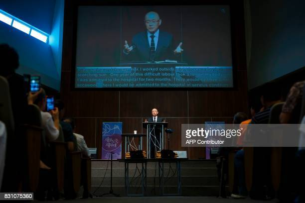 Canadian pastor Hyeon Soo Lim addresses media and his congregation at the Light Korean Presbyterian Church in Mississauga on August 13 2017 after...