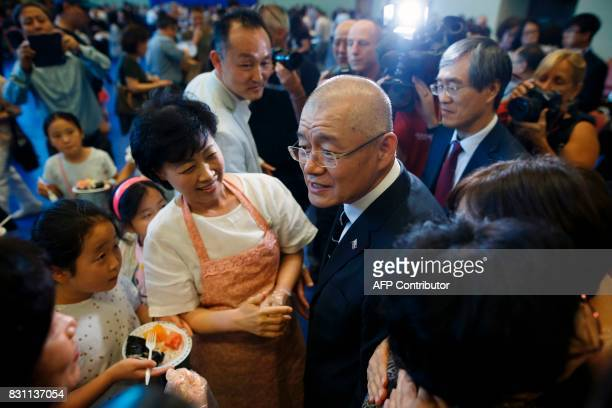 Canadian pastor Hyeon Soo Lim is greeted by members of his congregation at the Light Korean Presbyterian Church in Mississauga on August 13 2017...