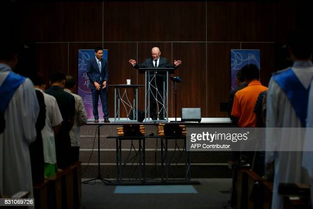 Canadian pastor Hyeon Soo Lim offers benediction at the end of service at the Light Korean Presbyterian Church in Mississauga on August 13 2017 after...