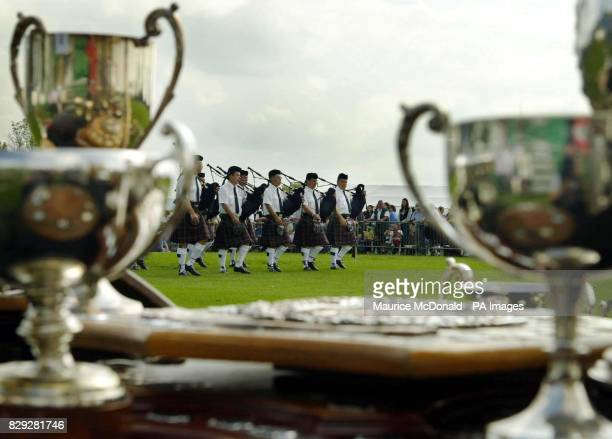 A Canadian pipeband being judged with a selection of trouphies laid out for the winners during the world Pipe Band Championship Glasgow Green Scotland