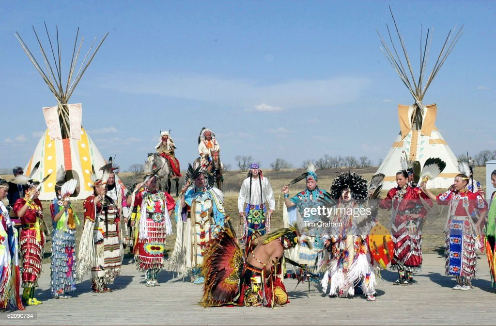 Canadian Plains Indians Including Sioux, Dakato, Dene And Cree, Wearing A Traditional Costumes Dancing As Part Ofthe Welcoming Ceremony For Prince Charles During His Visit To Wanuskewin Heritage Park, Saskatoon , Canada.