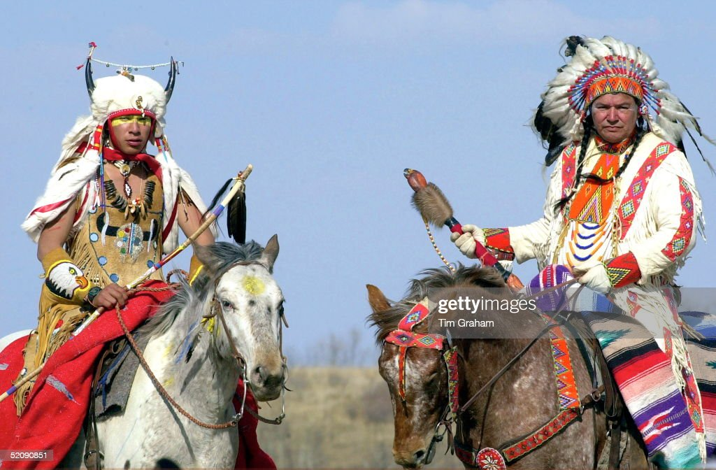Canadian Plains Indians On Horseback Taking Part In The Welcoming Ceremony For Prince Charles During His Visit To Wanuskewin Heritage Park, Saskatoon , Canada.