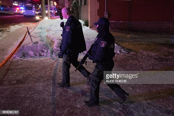 Canadian police officers patrol after a shooting in a mosque at the Québec City Islamic cultural center on SainteFoy Street in Quebec city on January...