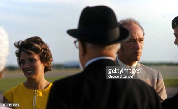Canadian politician and Prime Minister Pierre Trudeau and his wife Margaret speak with unidentified people outdoors 1972s