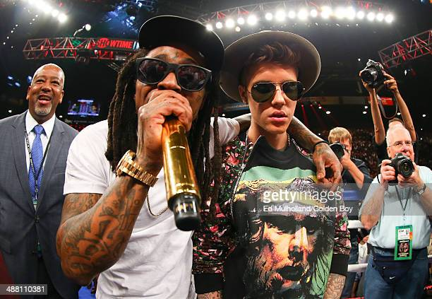 Canadian pop musician Justin Bieber and American rapper Lil' Wayne in the ring before the start of the fight between Floyd Mayweather Jr and Marcos...