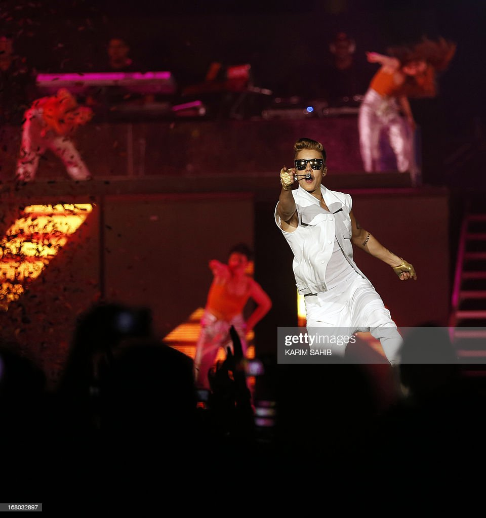 Canadian pop star Justin Bieber, 19-years-old, performs in front of a crowd of 15,000 fans at the Sevens Stadium in Dubai, on May 4, 2013. This is Bieber's first visit to the UAE. AFP PHOTO/KARIM SAHIB