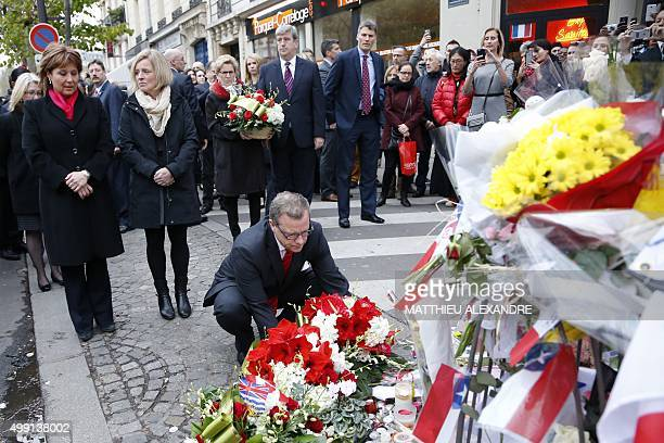 Canadian Premier Brad Wall lays flowers at a makeshift memorial in front of the Bataclan concert hall on November 29 2015 in Paris as Canada's...