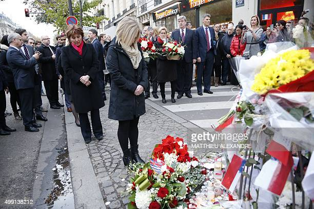 Canadian Premier Rachel Notley stands before a makeshift memorial in front of the Bataclan concert hall on November 29 2015 in Paris as Canada's...