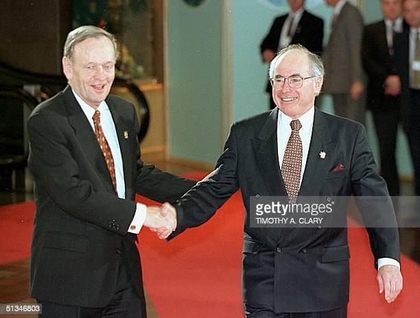 Canadian Prime Minister Jean Chretien greets Australian Prime Minister John Howard upon his arrival 24 November for the start of the leaders'...