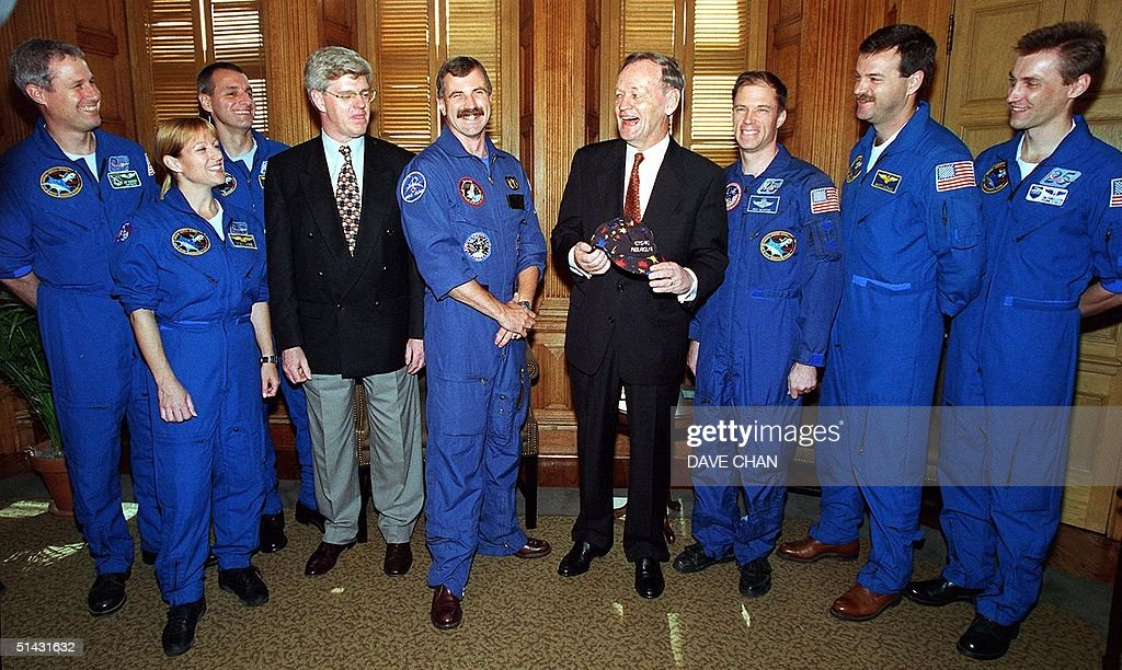 Canadian Prime Minister Jean Chretien meets with the crew of the US space shuttle Columbia mission STS90 June 15 during a visit to Parliament Hill in...