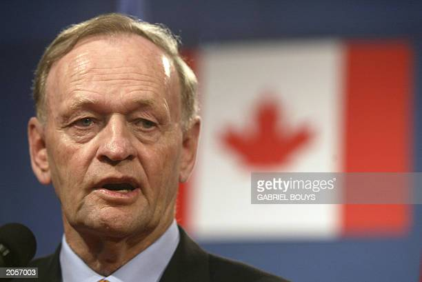 Canadian Prime Minister Jean Chretien speaks to the press after a working session on the second day of the Group of Eight summit in Evian 02 June...