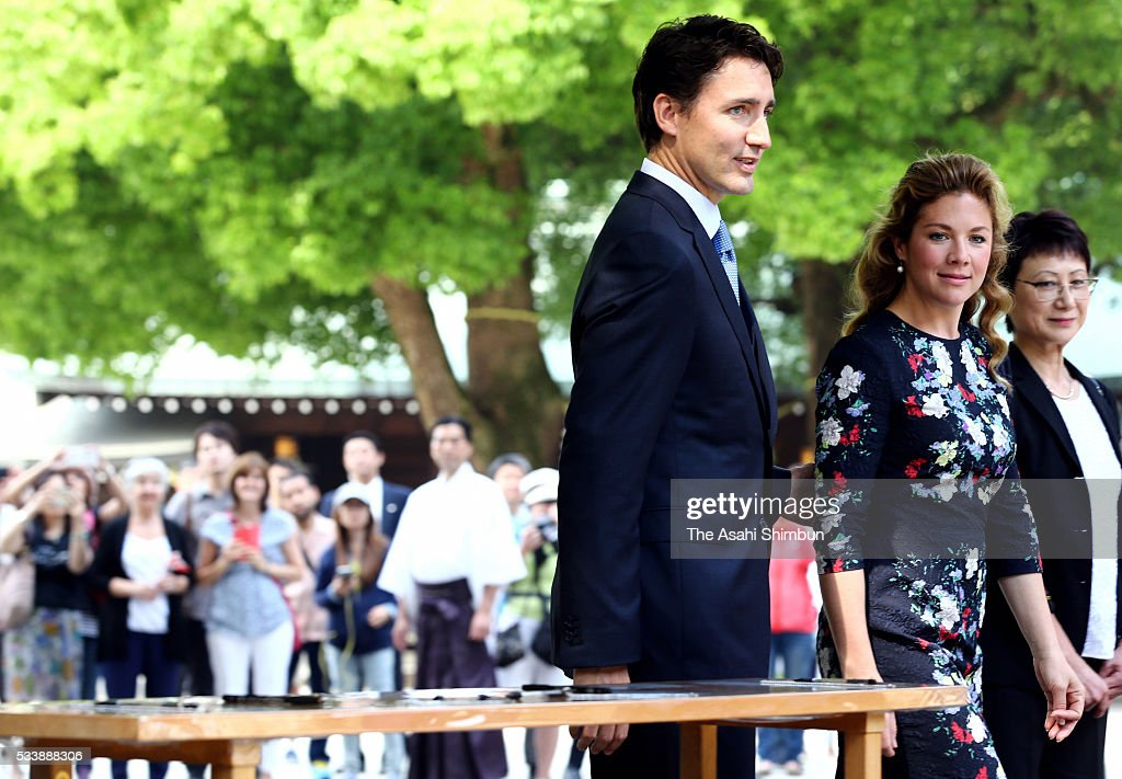 Canadian Prime Minister <a gi-track='captionPersonalityLinkClicked' href=/galleries/search?phrase=Justin+Trudeau&family=editorial&specificpeople=2616495 ng-click='$event.stopPropagation()'>Justin Trudeau</a> and his wife Sophie Gregoire are seen after writing messeges on 'Ema', wooden plaques during their visit Meiji Jingu Shrine ahead of the Group of Seven summit on May 24, 2016 in Tokyo, Japan. The Group of Seven summit takes place on May 26 and 27.