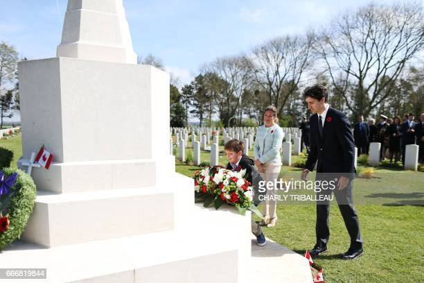 Canadian Prime Minister Justin Trudeau and his wife Sophie Gregoire watch their son Xavier lay a wreath at the remembrance monument in the Canadian...