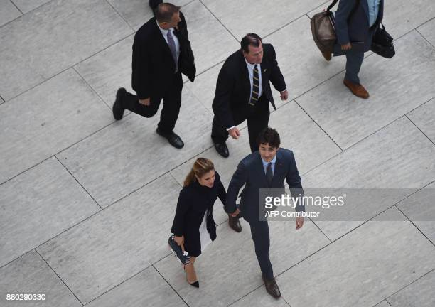Canadian Prime Minister Justin Trudeau and his wife Sophie Grégoire Trudeau leave the Canadian Embassy in Washington DC on October 11 2017 / AFP...