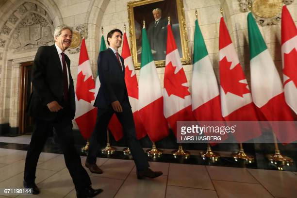 Canadian Prime Minister Justin Trudeau and Prime Minister Paolo Gentiloni of Italy arrive for a joint press conference in Ottawa Ontario April 21...