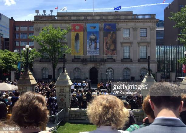 Canadian Prime Minister Justin Trudeau announces to a crowd the gifting of an old American embassy directly across the street from parliament to...