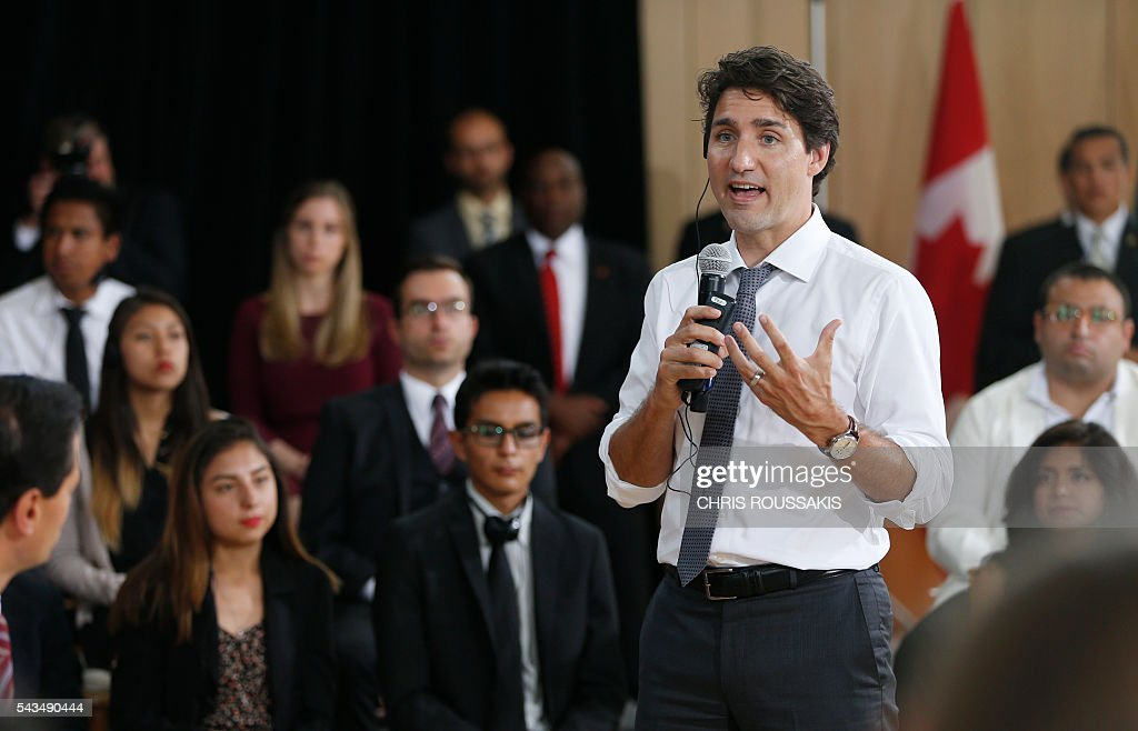 Canadian Prime Minister Justin Trudeau answers questions during a youth question and answer session ahead of the 'Three Amigos Summit' in Ottawa, June 28, 2016. Canadian Prime Minister Justin Trudeau and his guests US President Barack Obama and Mexican President Enrique Pena Nieto will meet in Ottawa for the North American Leaders Summit June 29 morning under a climate of economic uncertainty following Britain's vote to leave the European Union. / AFP / Chris Roussakis