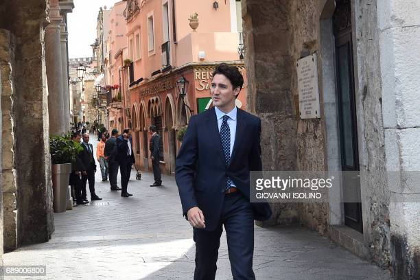 Canadian Prime Minister Justin Trudeau arrives to give a press conference at the end of the Summit of the Heads of State and of Government of the G7...