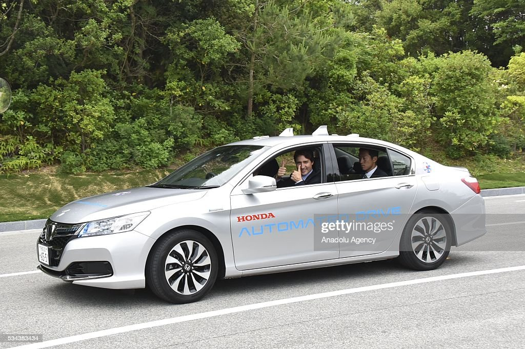 Canadian Prime Minister Justin Trudeau (L) gestures during the Automated-Driving and Fuel Cell Vehicle Presentation at Shima Kanko Hotel during the first day of the G7 leaders summit in the city of Ise in Mie prefecture, Japan on May 26, 2016.