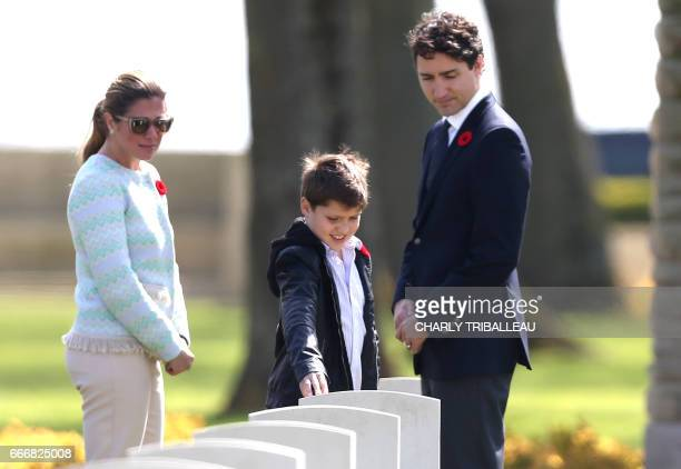 Canadian Prime Minister Justin Trudeau his wife Sophie Gregoire and their son Xavier visit the headstone of a member of Mrs Trudeau's family as they...
