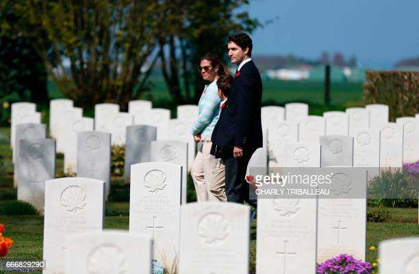 Canadian Prime Minister Justin Trudeau his wife Sophie Gregoire and their son Xavier visit the Canadian Military Cemetery of BenysurMer northwestern...