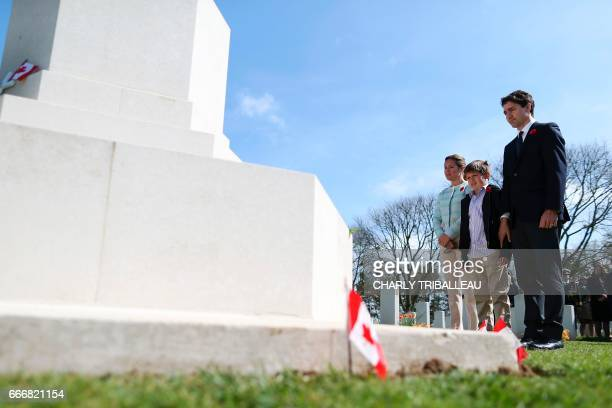 Canadian Prime Minister Justin Trudeau his wife Sophie Gregoire their son Xavier lay a wreath at the remembrance monument in the Canadian Military...